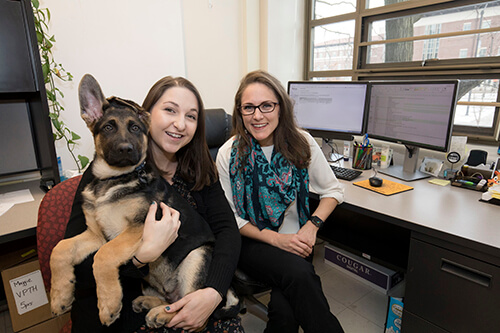 Dr. Maggie O'Haire, PVM assistant professor of human-animal interaction, with Kerri Rodriguez, human-animal interaction graduate student in PVM's Department of Comparative Pathobiology, and her dog Hendrix.