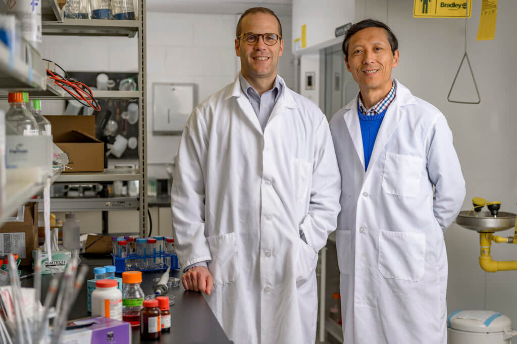 Dr. Chris Rochet and Dr. Riyi Shi pictured