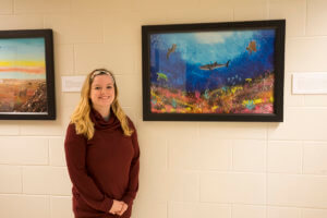 Brittany Crenshaw pictured with artwork