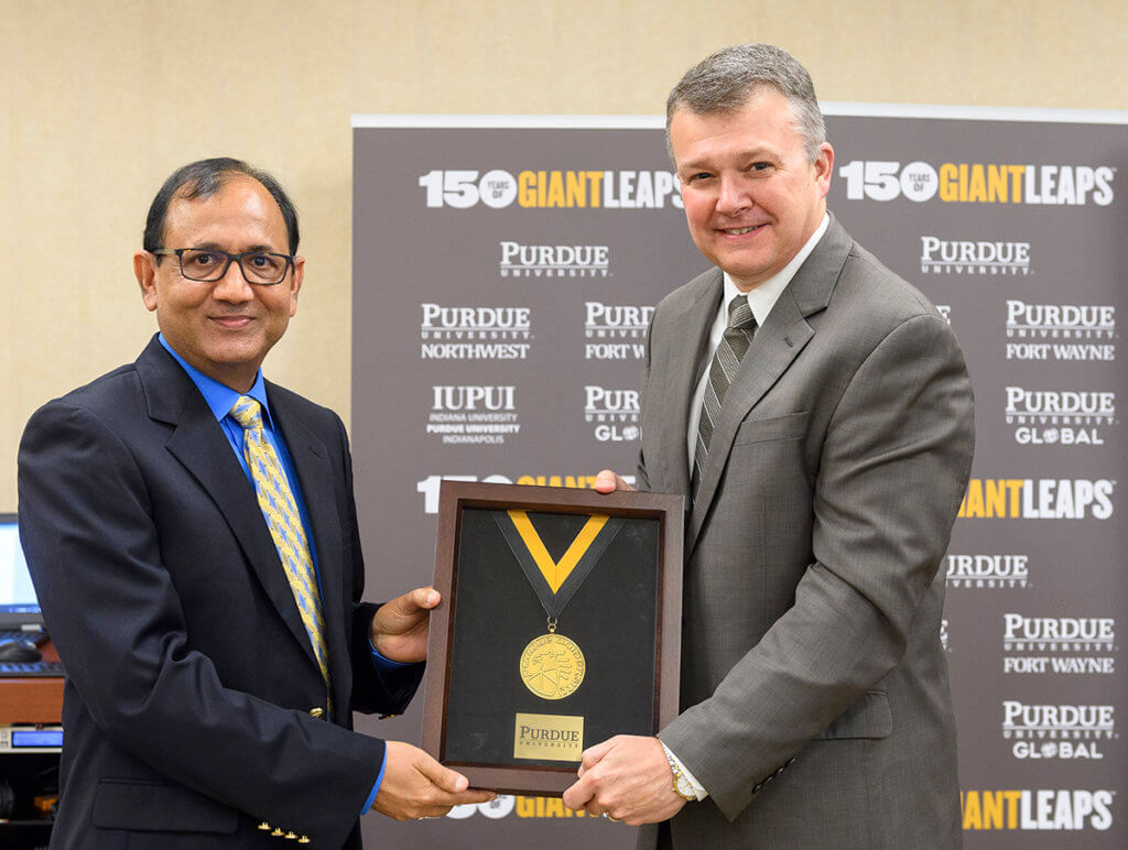 Dr. Mittal pictured with Provost Jay Akridge