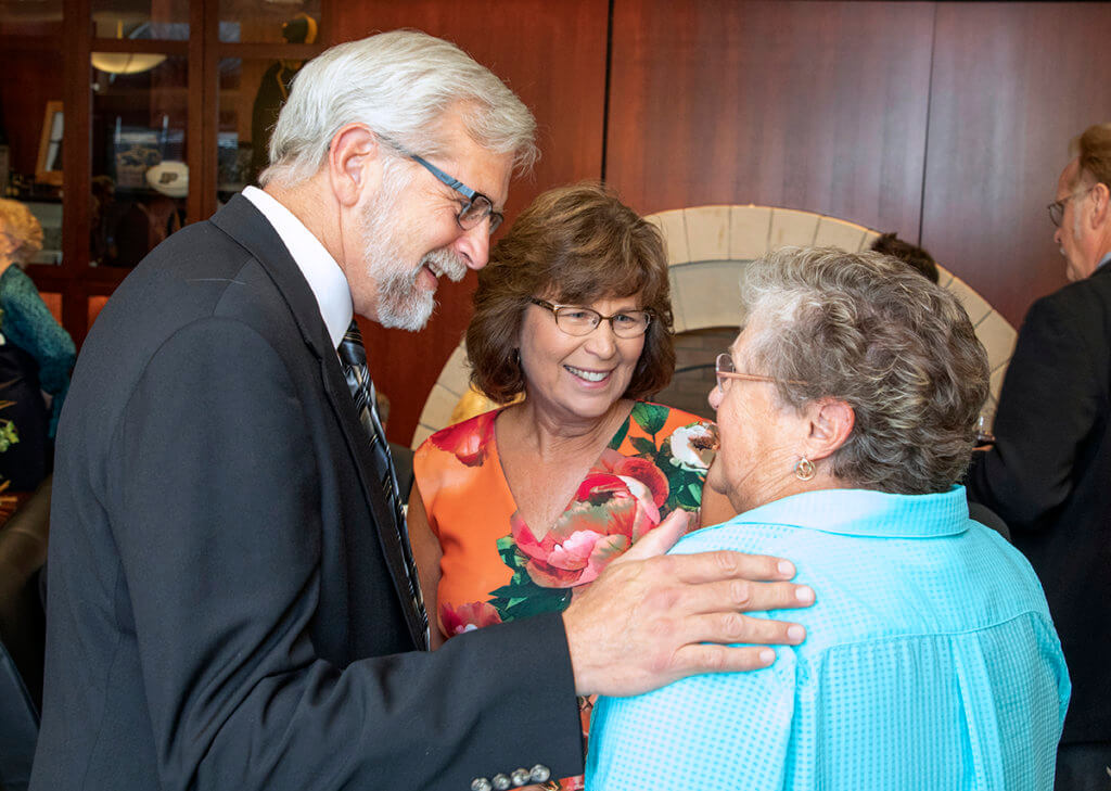 Dr. Larry Glickman pictured with his wife, Dr. Nita Glickman, and Gretchen Stephens
