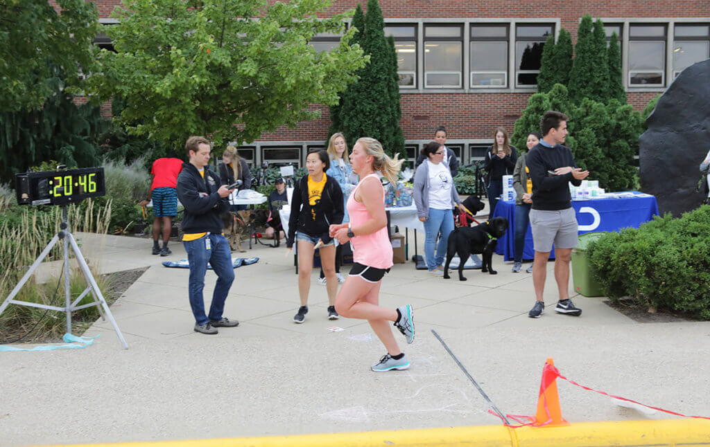 Taylor Bolinger pictured crossing the finish line