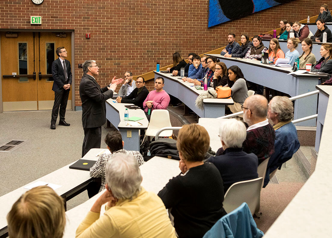 Dr. Jeff Bender answers questions in Lynn 1136 during the 2018 Coppoc One Health Lecture, which attracted a capacity crowd. Associate Dean for Research Harm HogenEsch (in background) introduced Dr. Bender and moderated the question and answer session.