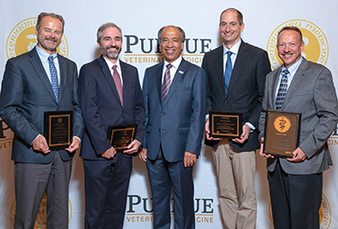 Dean Willie Reed with faculty award recipients (left-right) Drs. Laurent Laurent Couëtil, Michael Childress, Kevin Hannon, and Larry Adams.