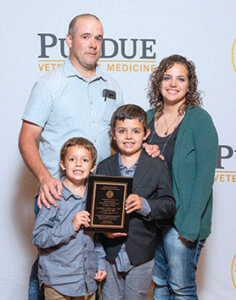 Candice Targgart's family pictured. She was honored posthumously.