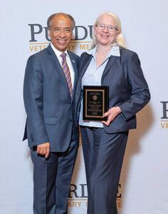 Dean Reed pictured with Dr. Amelia Woolums