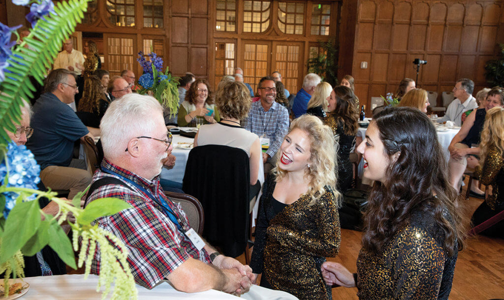 PMO's Purduettes serenade Dr. John Scharding of the Golden Anniversary Class of 1968 during the Meet Me @ the Mixer event