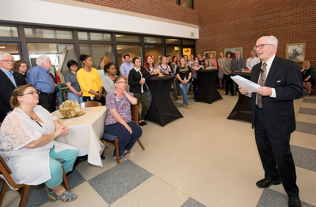 Dr. Hullinger pictured at reception with PVM faculty, staff, and students