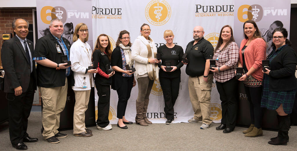 Staff recognized for 10 years of service to Purdue pictured with Dean Reed
