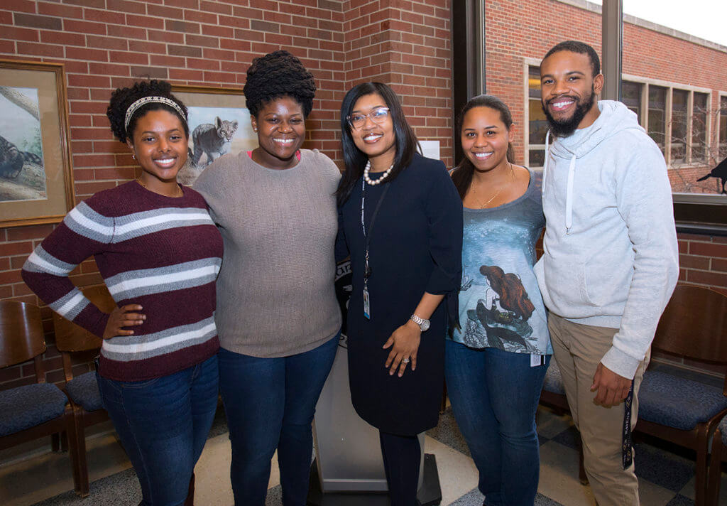 Dr. Craig pictured with students at welcome reception