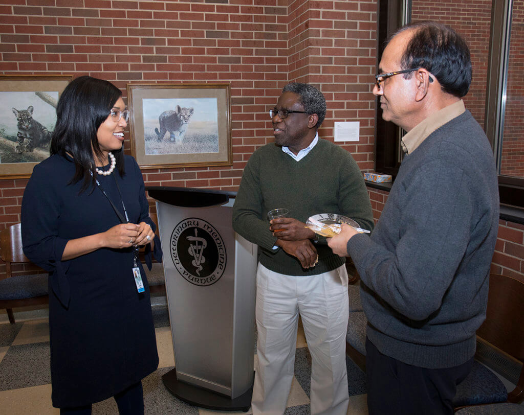 Dr Craig speaks with Dr. Asem and Dr. Mittal at her welcome reception