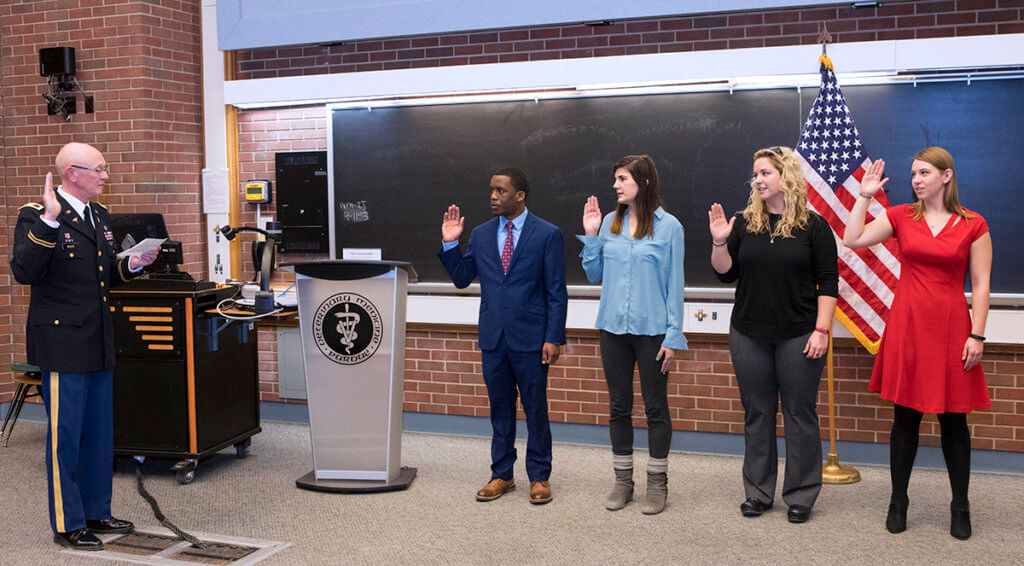 Dr. Moore administers oath of office during commissioning ceremony