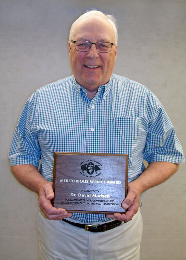 Dr. Madsen pictured with award plaque