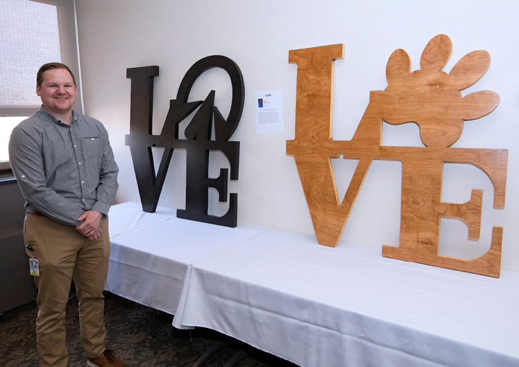 Thane Boyce pictured with his wooden sculptures