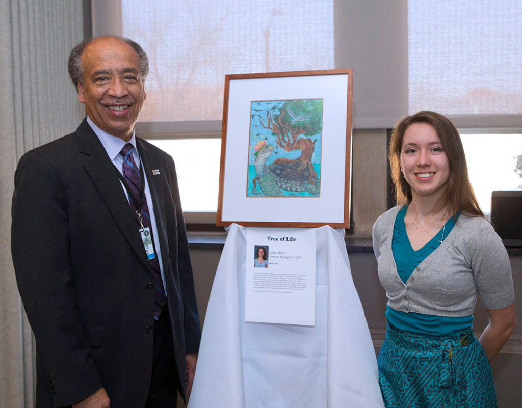 Emily Matson pictured with Dean Willie Reed and her mixed media artwork