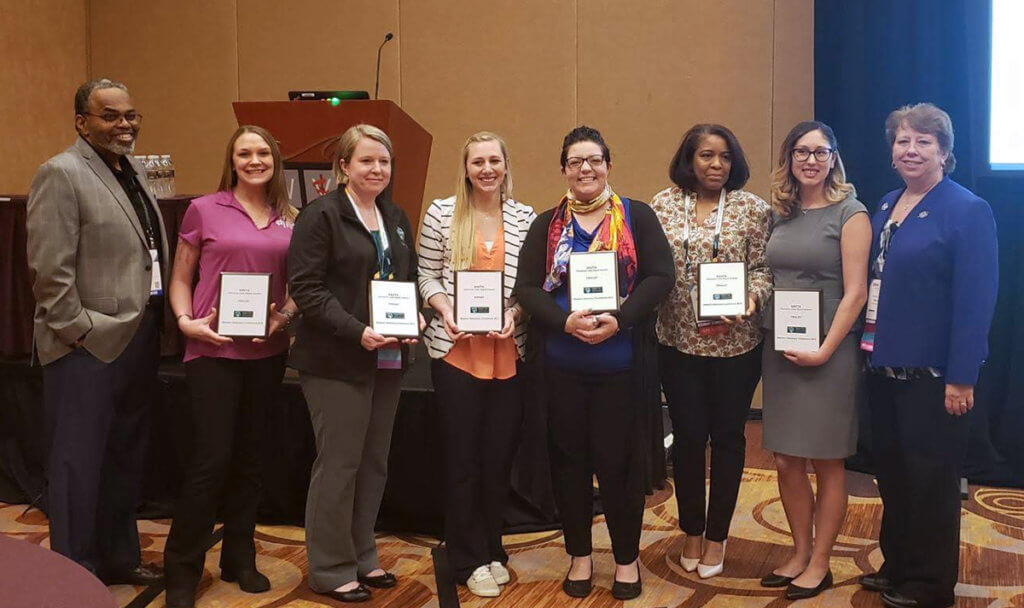 Jessica Bowditch pictured with veterinary technicians at the WVC Conference