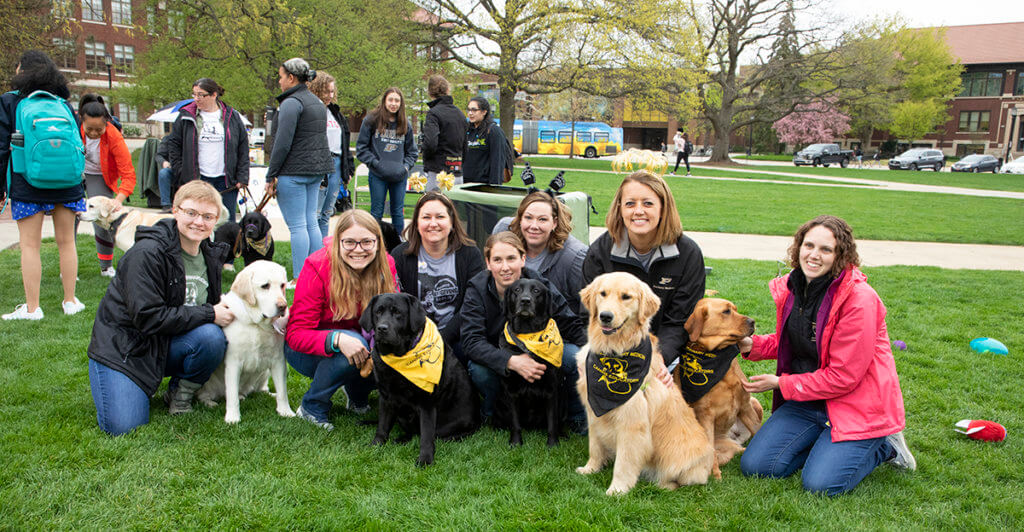 Love a Lab event volunteers and canine educators pause for a photo at Memorial Mall