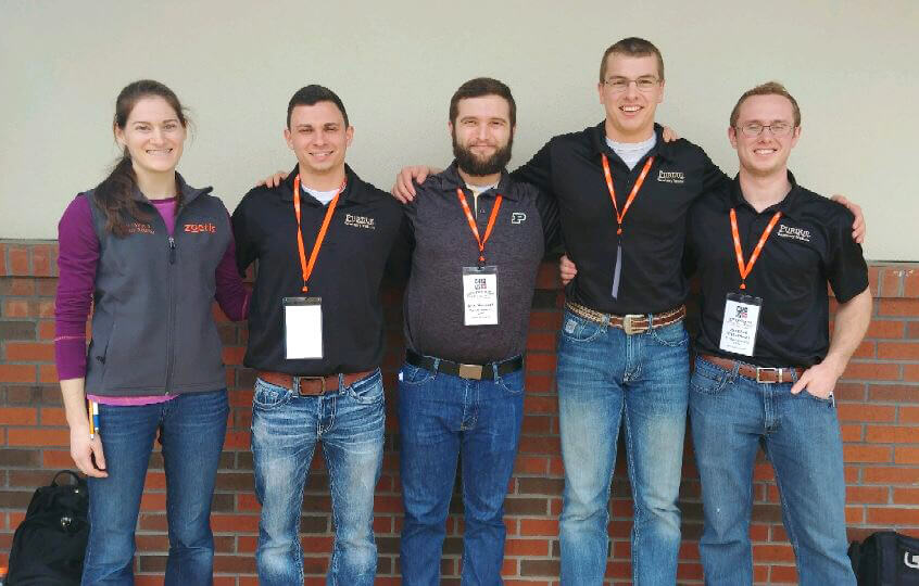 Team members of the Bovine Palpation Team stand together for a photo outside