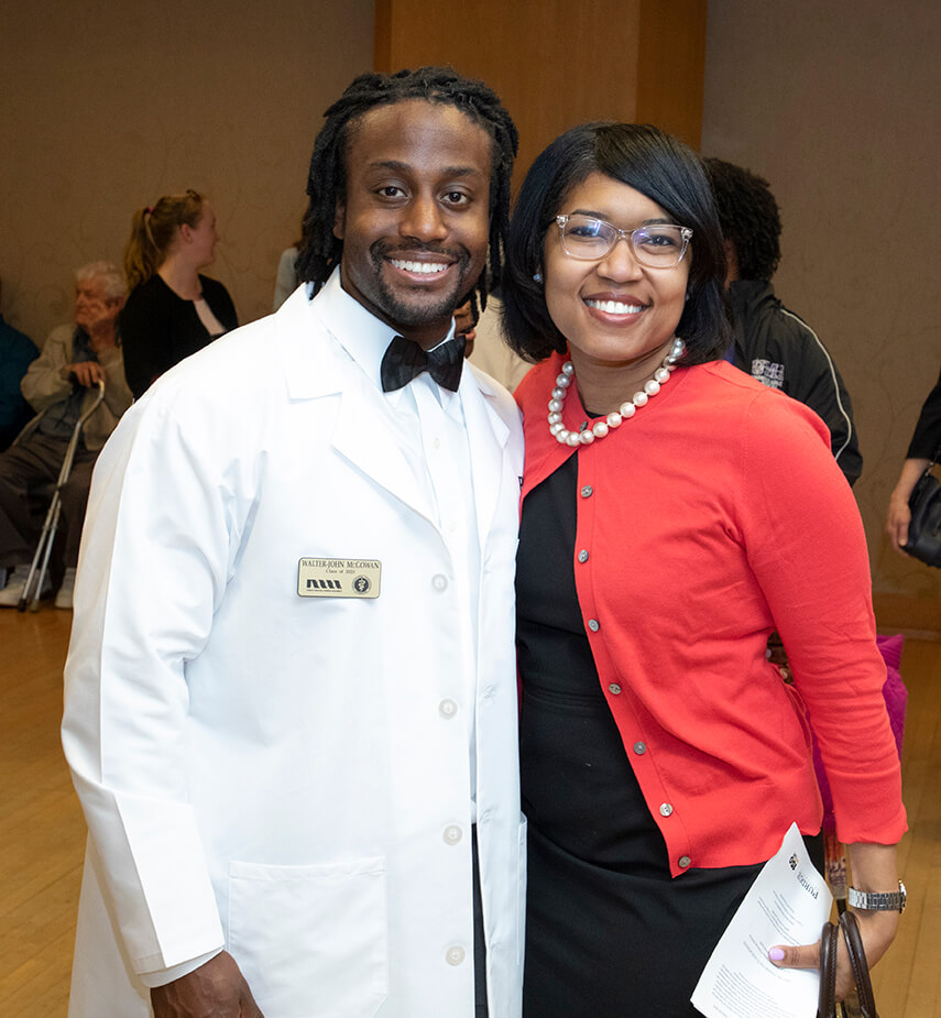 Walter-John McGowan stands beside Latonia Craig for a photo during the reception