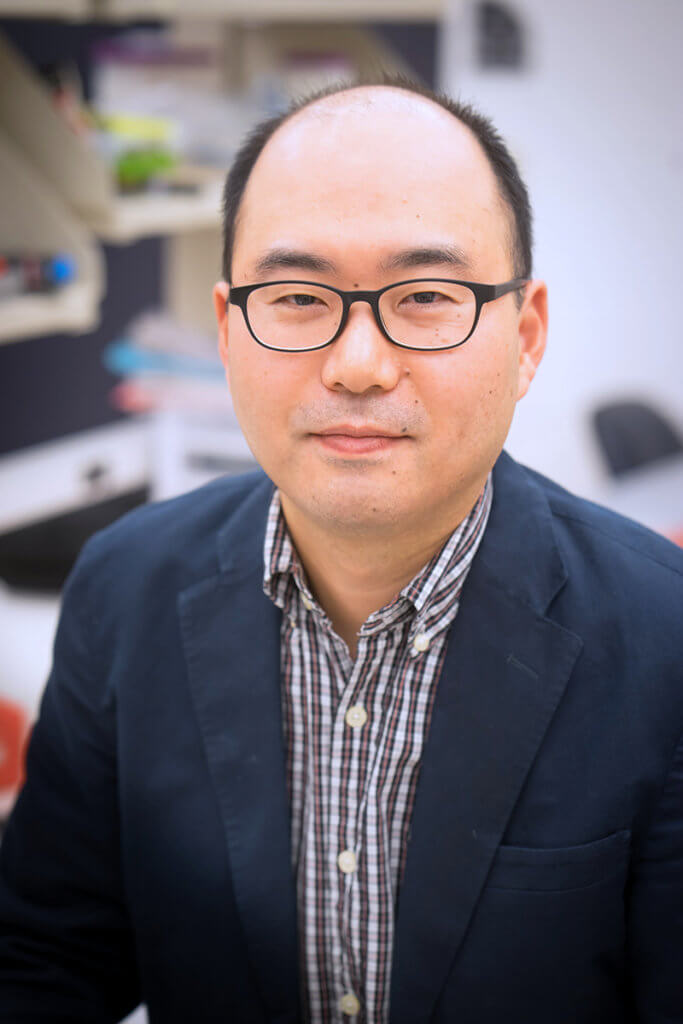 portrait of Dr. Kim in a lab