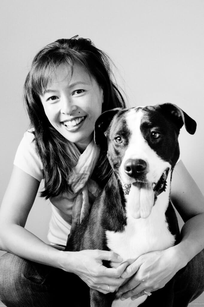 Justine Lee pictured holding her dog