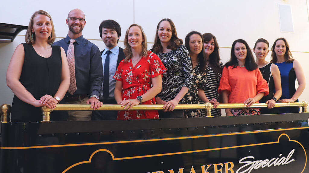 Graduating residents hop aboard a replica of the Boilermaker Special in DAUCH