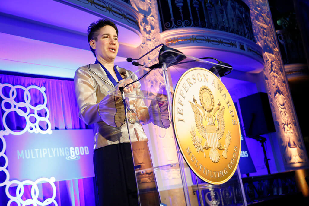 Dr. San Miguel speaks at the Jefferson Awards ceremony in Washington, D.C.