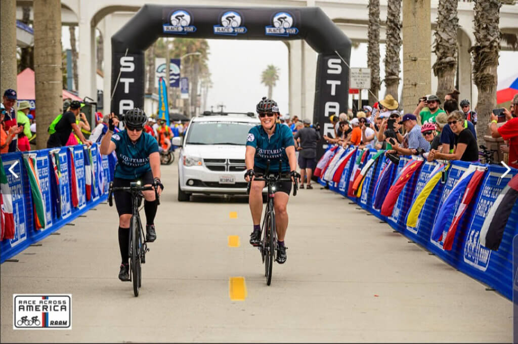 Molly and Sandy ride their bikes along the route just past the start line for Race Across the West