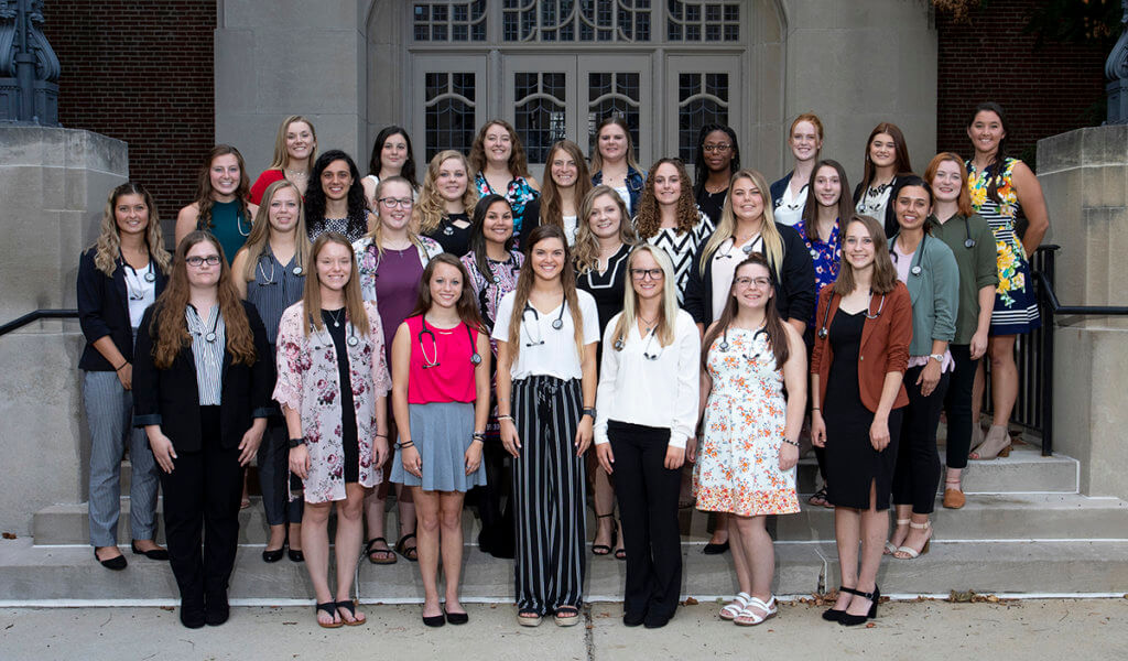Veterinary nursing students don their new stethoscopes on the steps of the Purdue Memorial Union