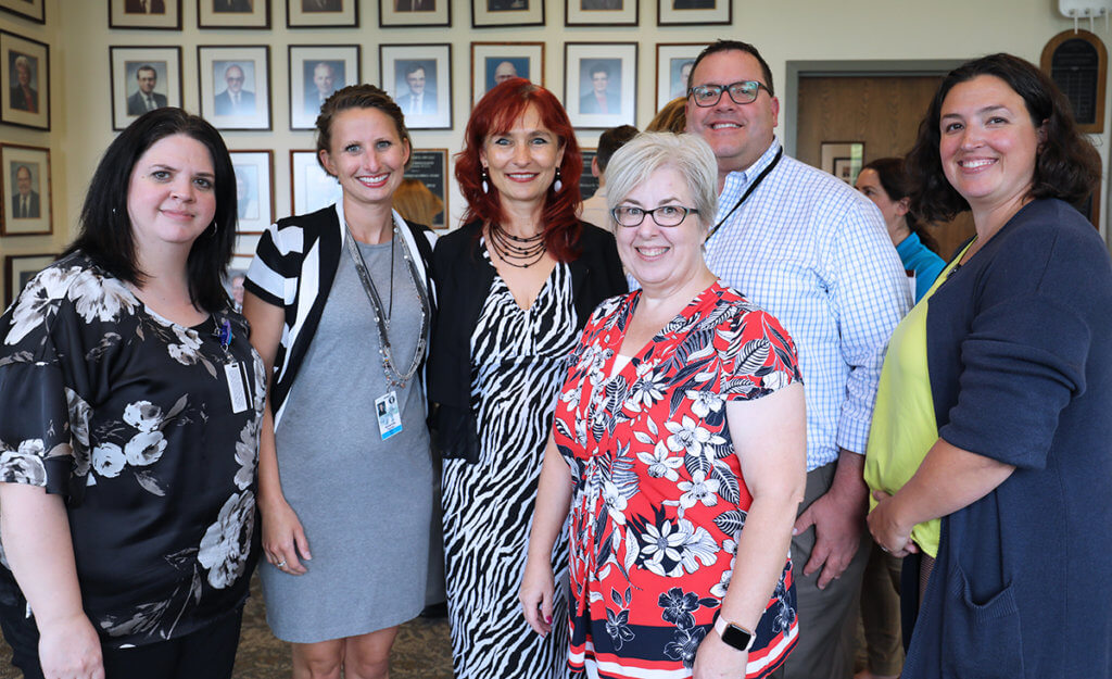 Dr. Nan stands with her Student Services colleagues at her farewell reception