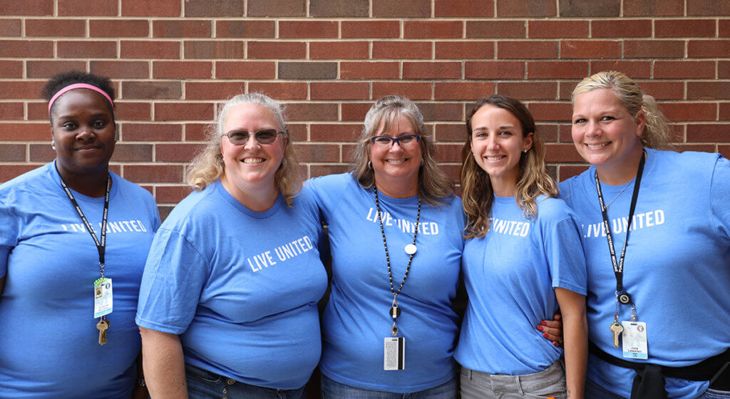 PVM's United Way committee volunteers stand together for a group photo outside Lynn Hall