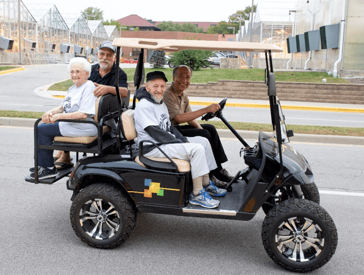 Dean Willie Reed, who drove Skip Jackson around the course on a golf cart that also carried Dr. Jackson's wife, Betty Ruth, and PVM alumnus and longtime race supporter and enthusiast Dr. Larry McAfee.