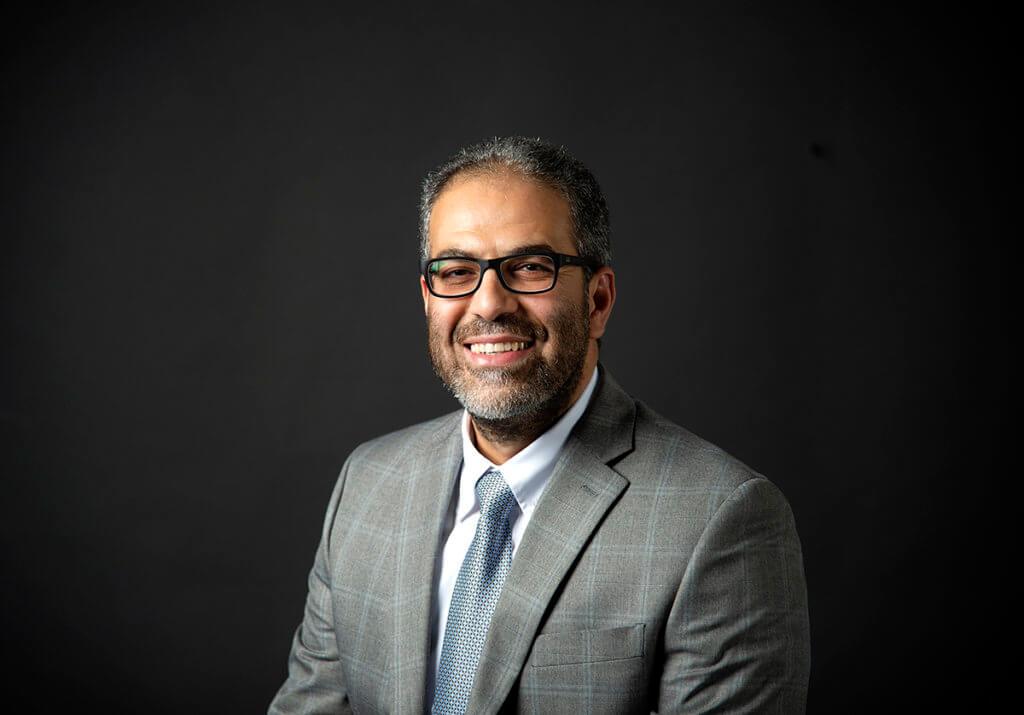 Mohamed Seleem pictured sitting against a dark background
