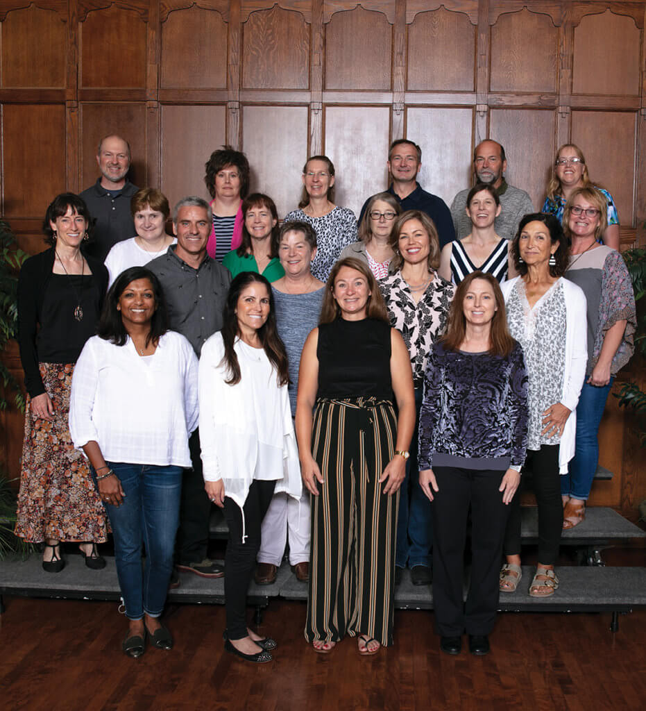 The DVM Class of 1994 gather for a group photo on risers in the Purdue Memorial Union ballroom