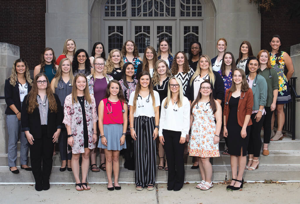 The class of veterinary nursing students stand together in rows outside the Purdue Memorial Union