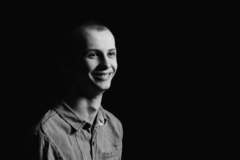 A black and white image of Tyler Trent smiling