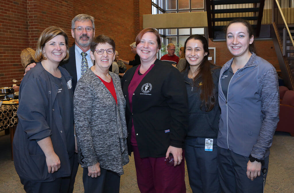 Kris is joined by her colleagues for a group photo in the Veterinary Medical Library following her retirement reception