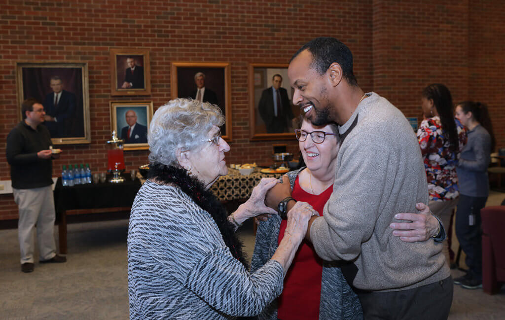 Dr. Green smiles as he gives Kris a hug as he and Kris listen to her mom