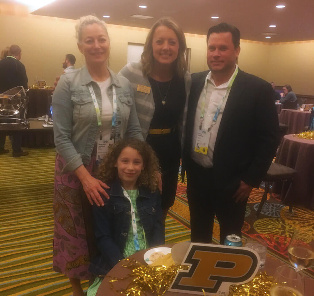 Tanya joins Dr. Willard, her husband Chris and daughter at their table at the alumni reception
