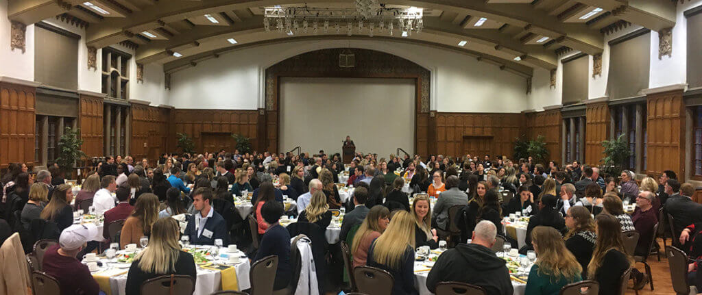 Interviewees and their families are seated at the admissions banquet event in the Purdue Memorial Union Ballroom