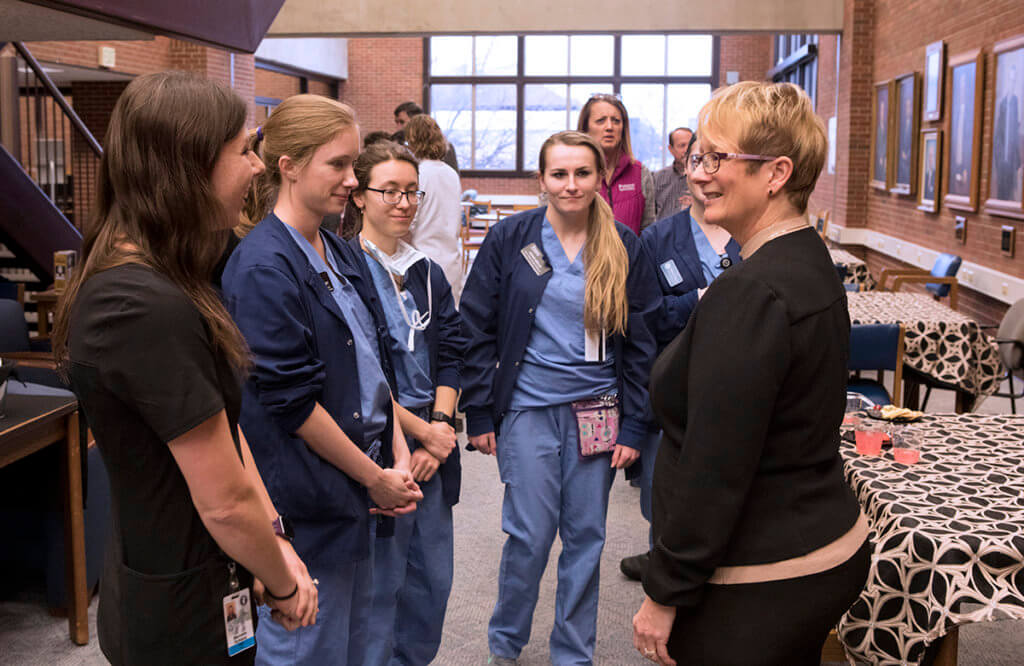 Dr. Lowery speaks with a group of veterinary nurses at her welcome reception