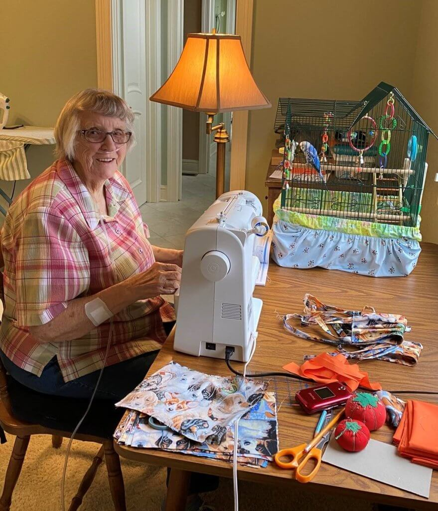 Dr. Lowery's mom sits in front of her sewing machine at work
