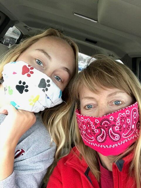 Mary Jayne and Claire take a selfie wearing facemasks