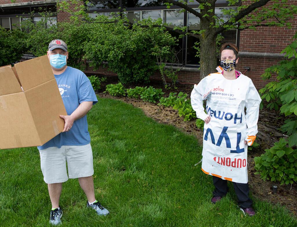 Nathan and Tami stand outside the Small Animal Hospital