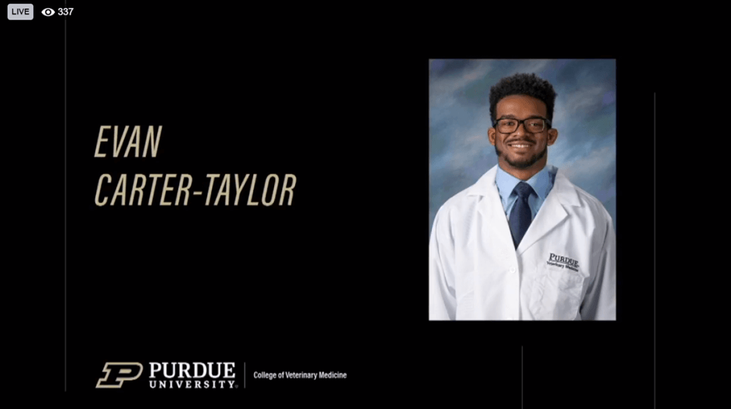 Evan Carter-Taylor is pictured wearing his white coat