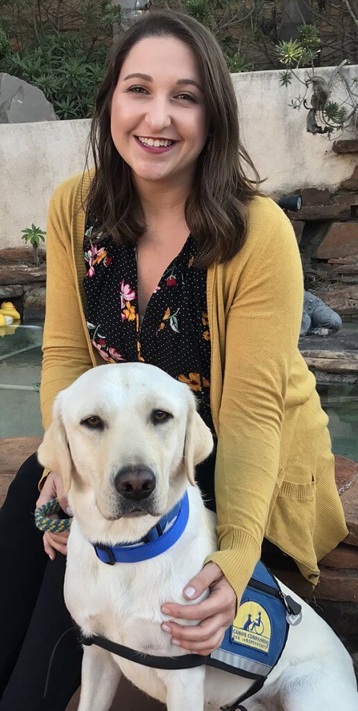 Kerri pictured with a service dog