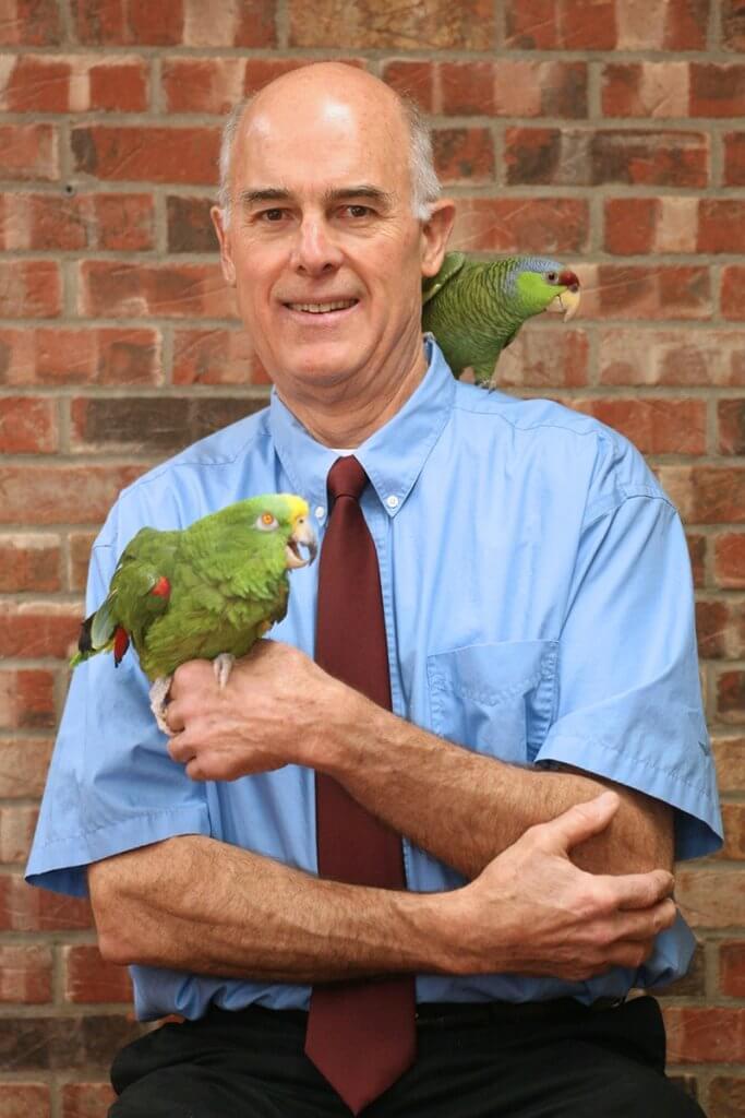 Dr. Donn Griffith and exotic birds portrait