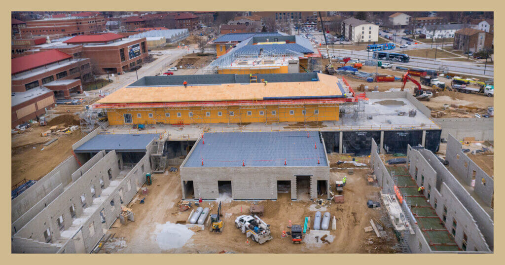 A photo shows an overhead view of construction progress on the new equine hospital and small animal hospital adjacent to the existing facilities