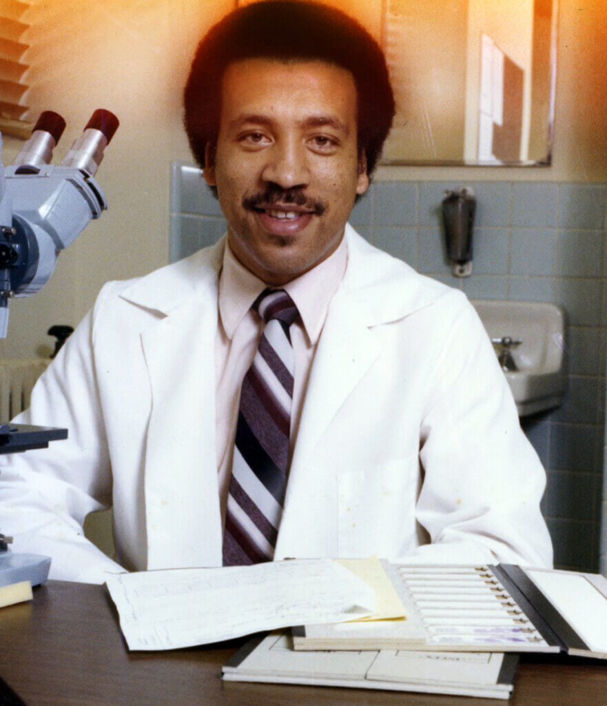 Dean Reed pictured working in a lab early in his career at Purdue