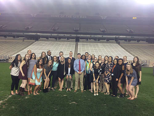 Purdue Veterinary Medicine's contingent of SAVMA Symposium attendees pauses for a photo-op in Texas A and M's football stadium, famous as the 'Home of the 12th Man'